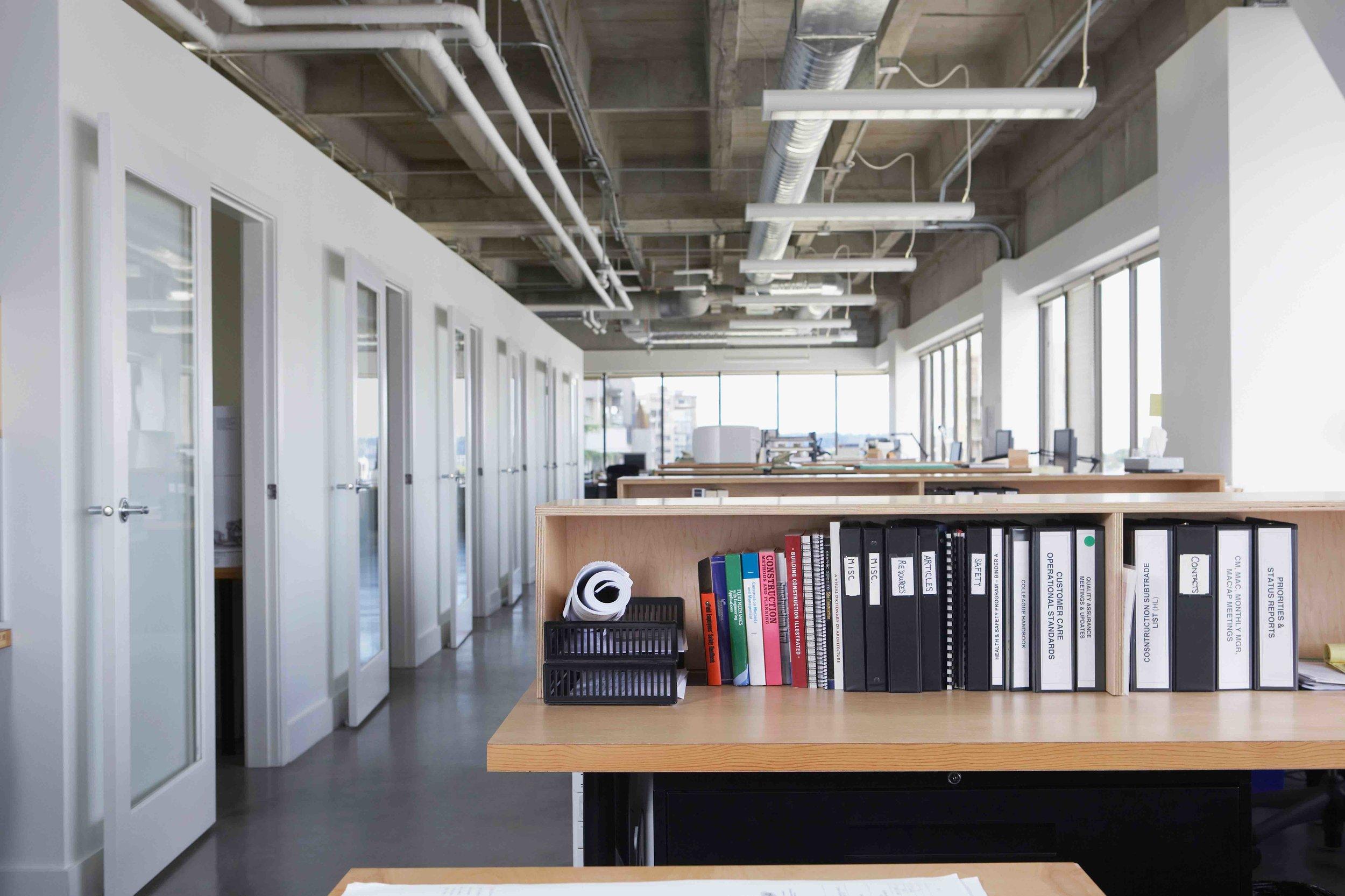 Canva - Folders on desk in empty office.jpg