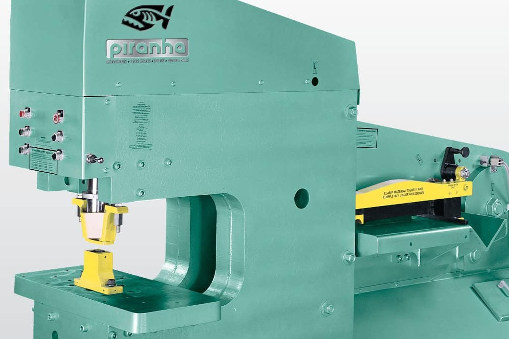 Piranha Model Pii-140 Iron Worker - Ironworkers are a class of machines that can shear, notch, and punch holes in steel plate. With 140 tons of punching force, the Piranha Model Pii-140 is truly the king of the single operator ironworkers.