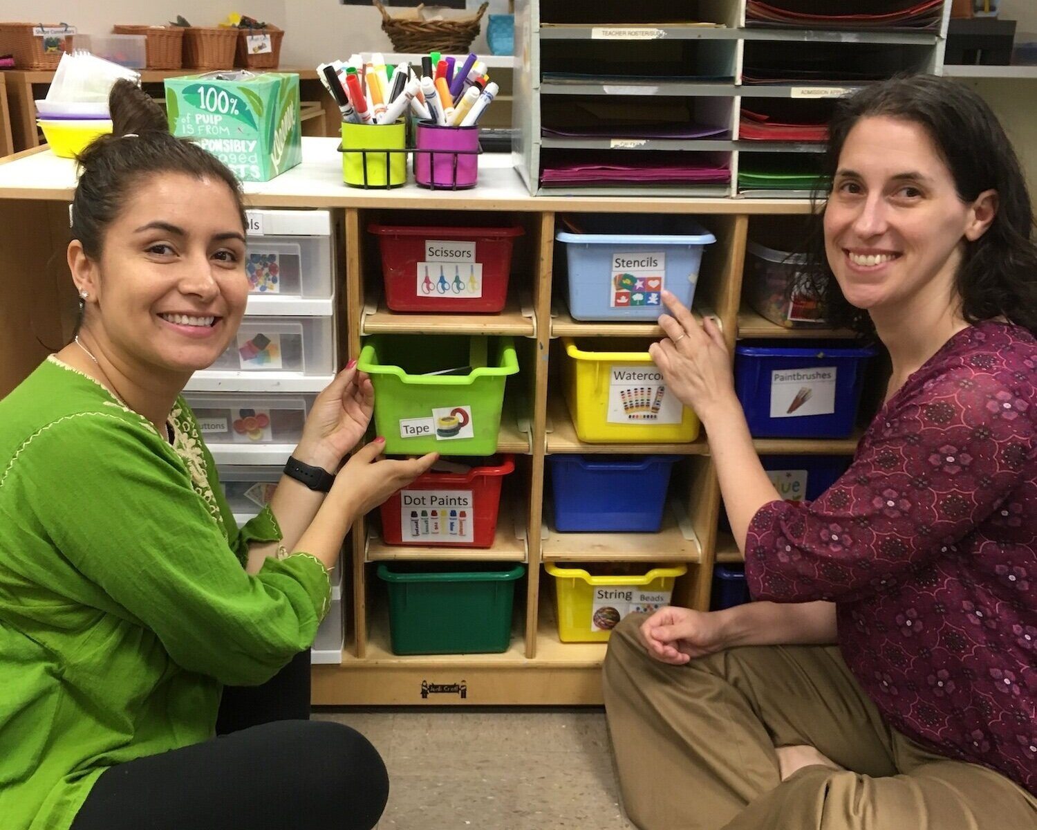 Rebecca and teacher with art supplies.jpg