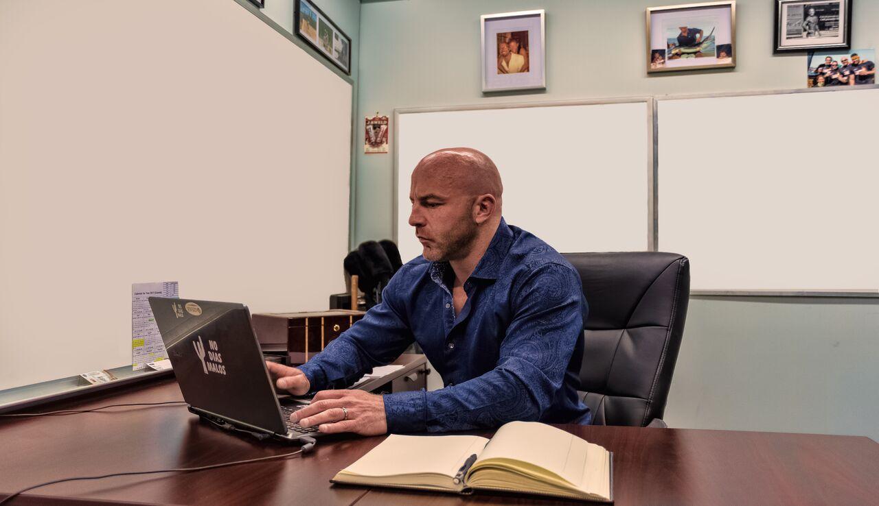 Kevin Kuly at Desk.jpg