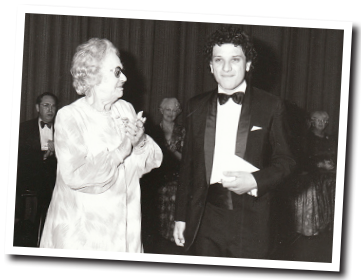 1981 PROFESSOR OF VIOLIN   Appointed as the youngest-ever professor of violin at the Royal Northern College of Music, going on to make his official debut with the Philharmonia Orchestra in a live broadcast from the Royal Festival Hall. Seen above with Dame Eva Turner.