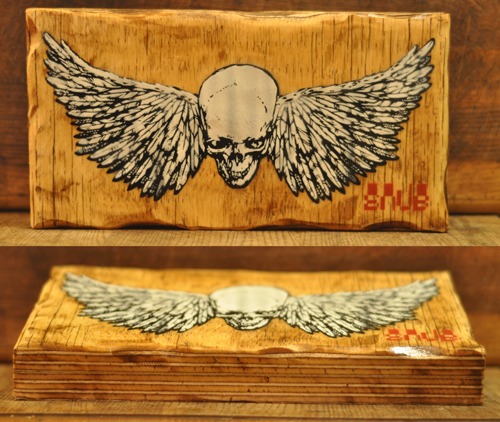 SKULL & WINGS ON WOOD  Stencil on thick plywood.EDITION OF 4 Laquer finish 28cm x 14.5cm x 3.5cm
