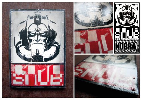 SNUB STEEL STICKER 2011  First prototype of new batch of SNUB steel, currently producing a limited edition run but this artist proof. Stenciled steel plate riveted to wooden panel. 1 of 1 Artists proof 30cm x 21cm x 2cm Signed stamped and numbered. Postage and packing included.