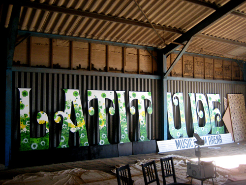 So I'm finally back from Latitude. Not all necessarily SNUB style work but hardcore work none the less. I'm estimating that myself, Miss SNUB and EyeSaw painted about 100 metres of 8ft wall. Mostly repeat wallpaper patterns in A2 sections. Lots of highlights to a week in the country working in a grain store and sleeping in a tent, but the best bit for me was working with my good lady and best friend Miss SNUB. This is just a small part of the work she knocked out throughout the week . Next year the organisers say she'll be commissioned properly just like me as she's way more than just an assistant. I couldn't be more proud 🙂