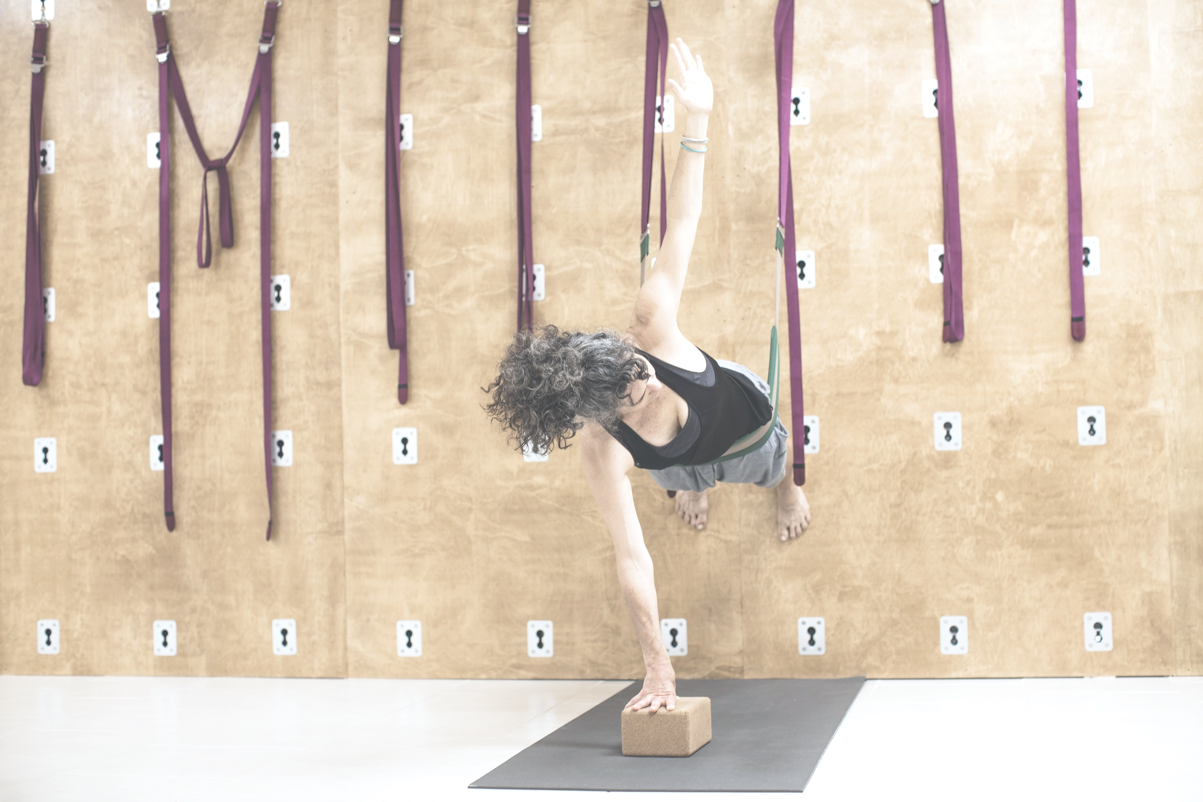 Wall Yoga  The wall rope system is used as the ultimate prop to enhance asana by providing a deep opening in the body. Students learn how the body aligns in postures with the added support of wall straps. We recommend some experience with yoga to feel at ease during the Wall Yoga class.