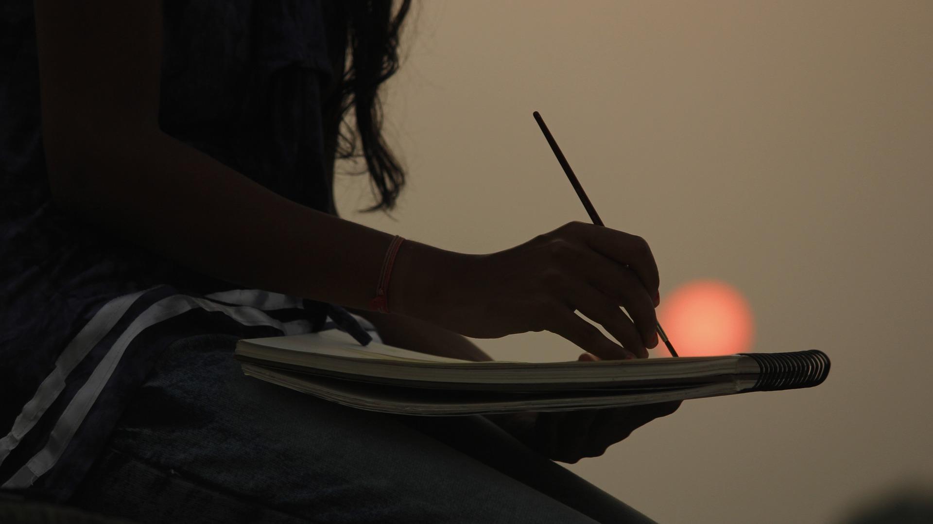 artist-writing-relax