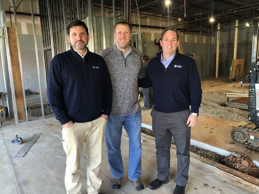 Kevin Gais, Dave Hamme and Michael Gais on the site of the future Lost Worlds Brewing.