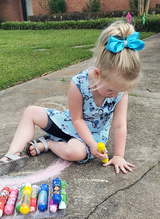 picture of girl drawing with chalk small.jpg