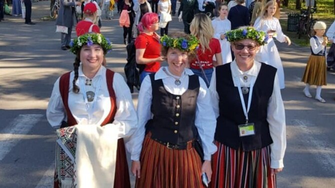 """""""Me with my two older sisters (I'm in the middle) in Latvia's beautiful Mežaparks, a beautiful woodland park that includes a huge outdoor concert venue where the giant combined choir concerts were held. We are wearing our folk costumes."""""""