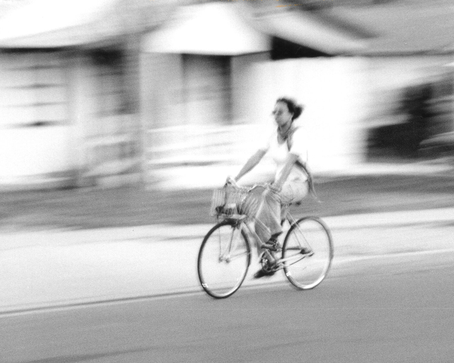 laura_farrell_photography_helen_on_wheels_black_and_white_bicycle_pan.jpg