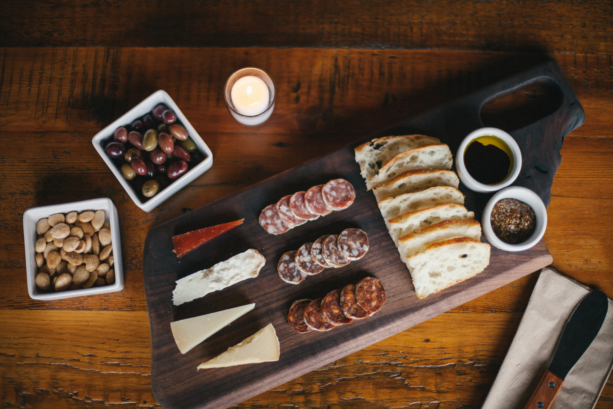 let's pair it up! - With our assortment of local meats and worldly cheeses, you'll satiate your hunger and compliment whatever is in your glass. Almonds, Olives and Chocolates, too!