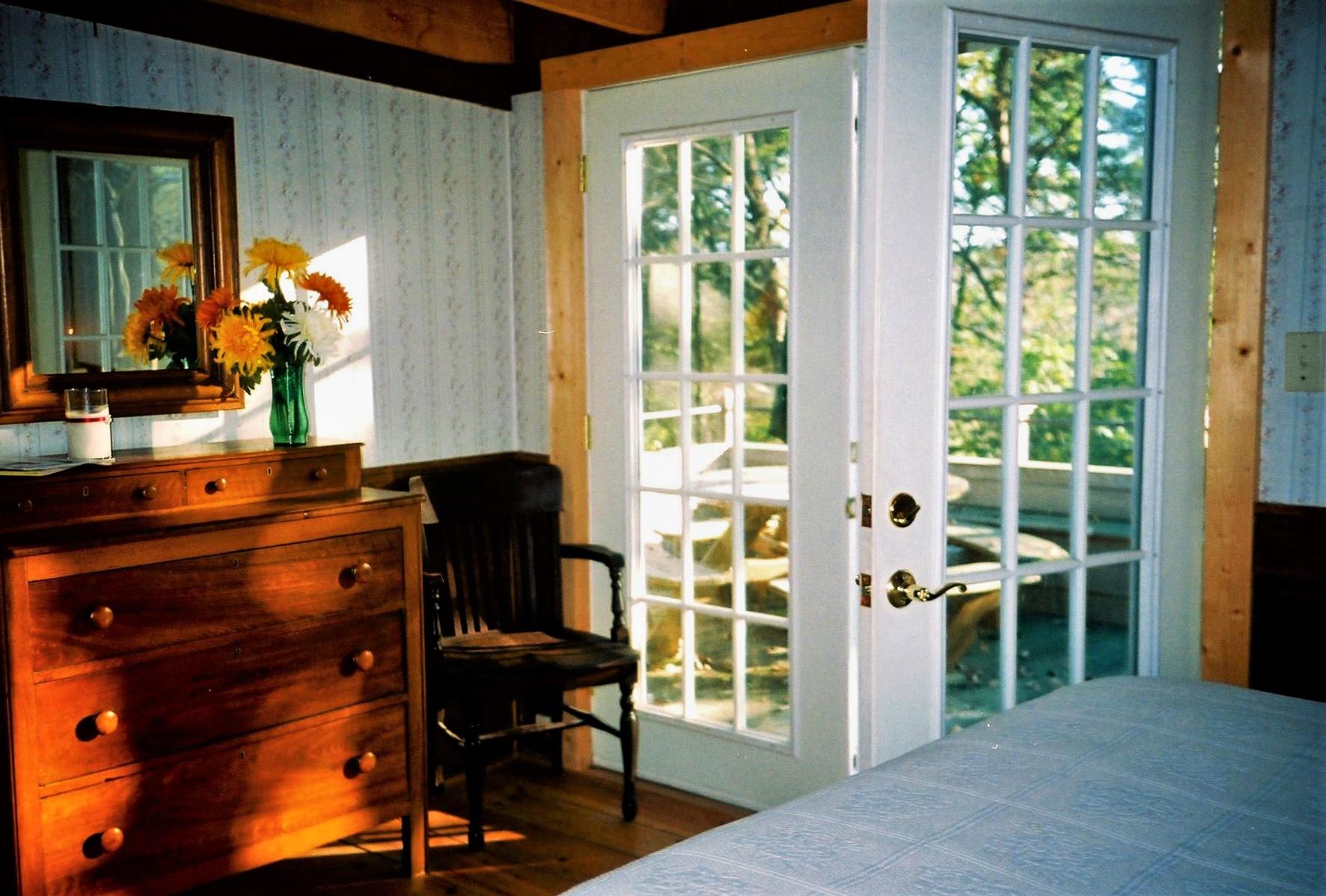 Antonia Albano Retreat   DeHart Cabin   Bedroom with Porch Entry.jpg