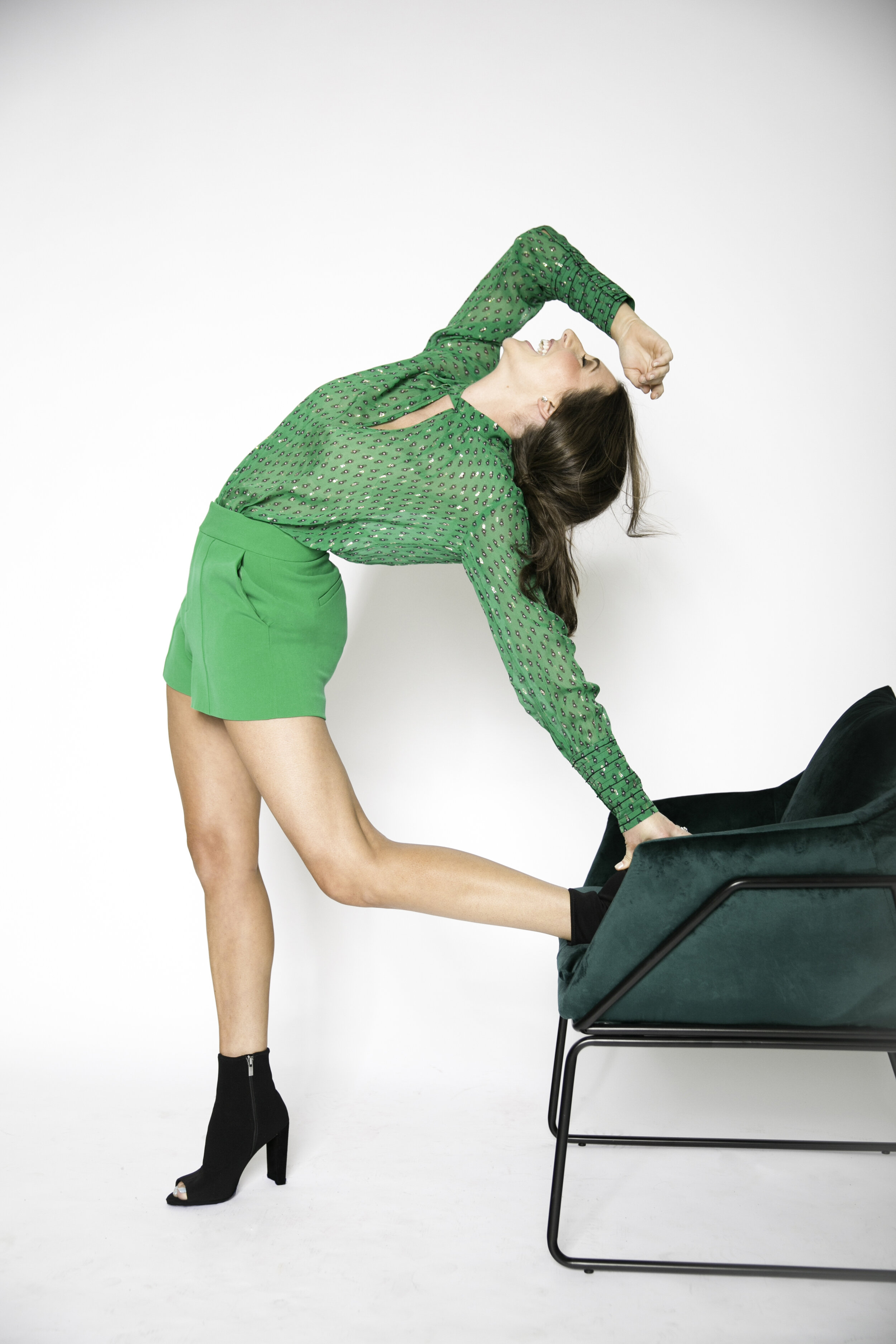 Top ( Green), $275, Shorts, $265; Debra's; 251.343.7463. Booties, $170; The Gallery Shoe Boutique, 251.344.4257.