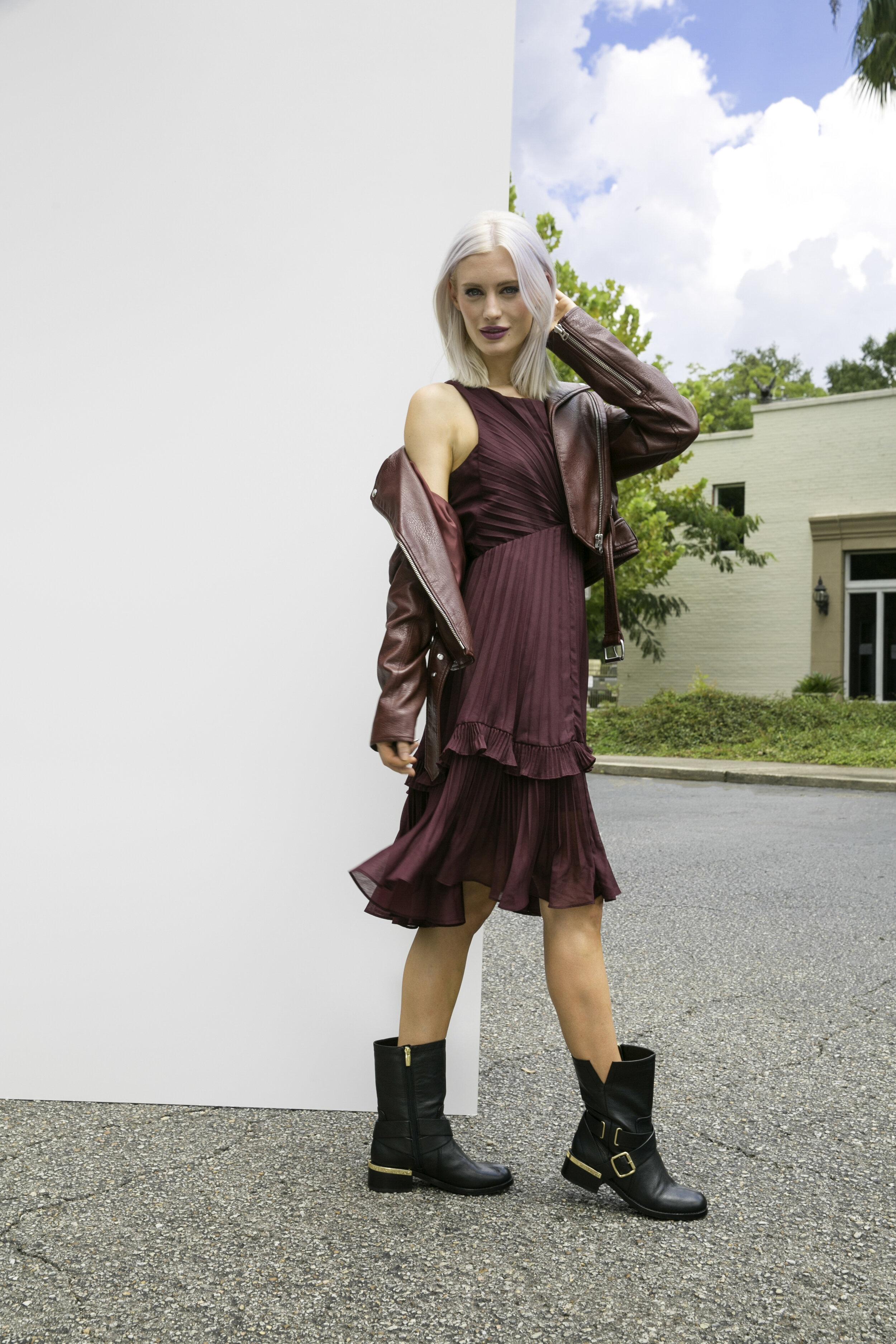 Dress (berry), $495; DUH Pensacola, 251.439.0640. Leather Jacket, $189; Debra's; 251.343.7463. Boots, $169; Dillard's, 251.471.1551.