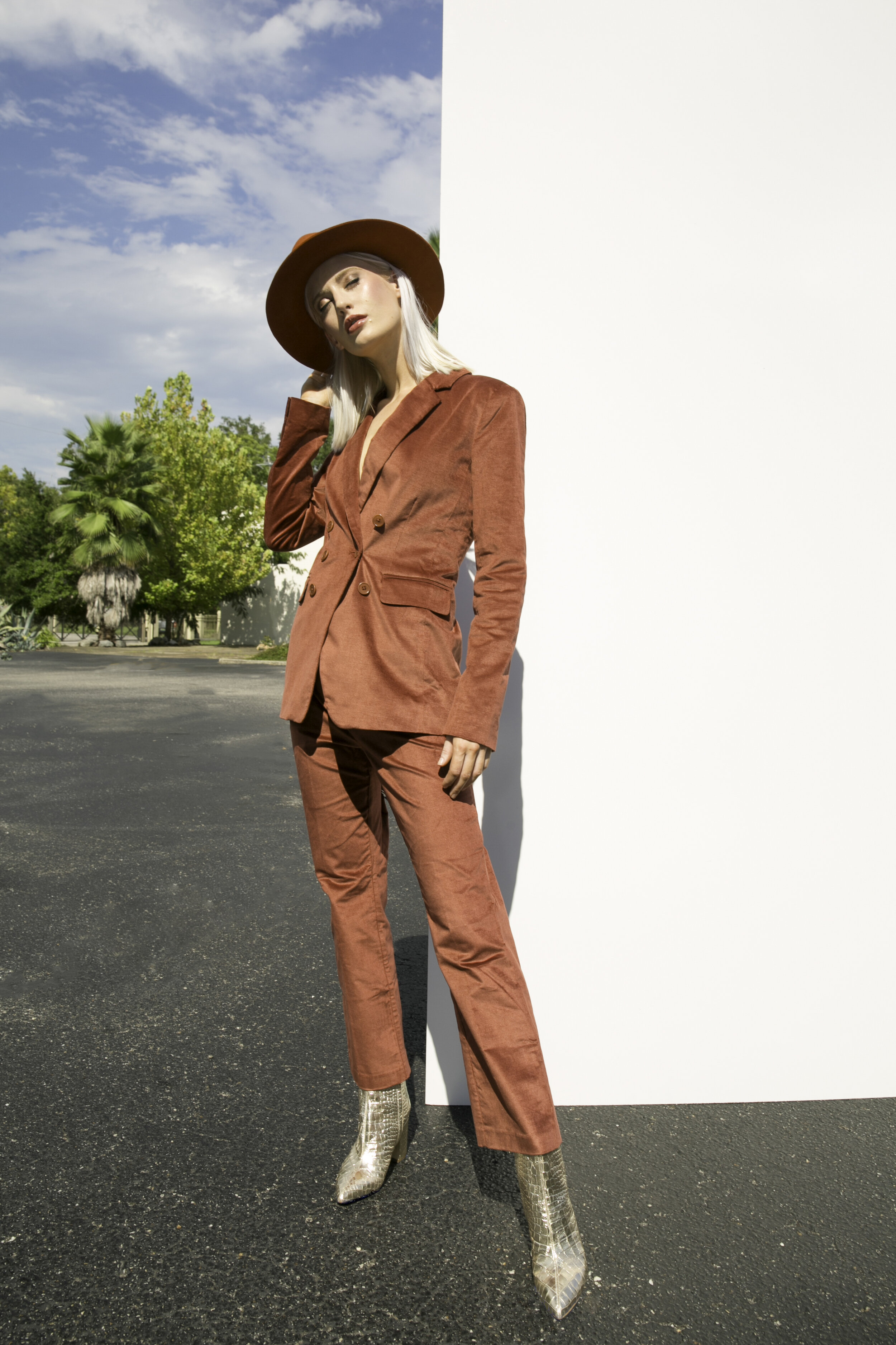 Suit Jacket, $329, Pant, $189; DUH Pensacola, 251.439.0640. Bootie, $180; CK Collection, 251.990.9001. Hat, $70; The Holiday, 251.342.4911.