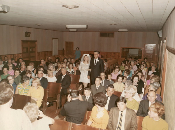 Wedding of Margaret Curbo to Bert Brunett in 1968. This was one of the last ceremonies performed in the old 'Towash Building'.