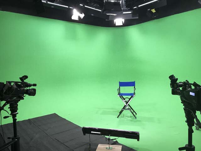 Broadcast Stage - 50 ft of green cyclorama with 14 ft grid plus control room in a sound treated stage plus master control room featuring switchers and virtual sets.