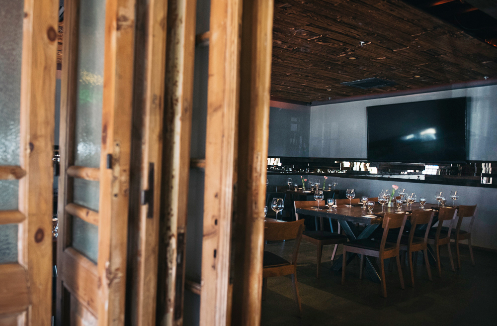 Our private dining area includes foldable screen doors to shield from the dining room, and televisions.