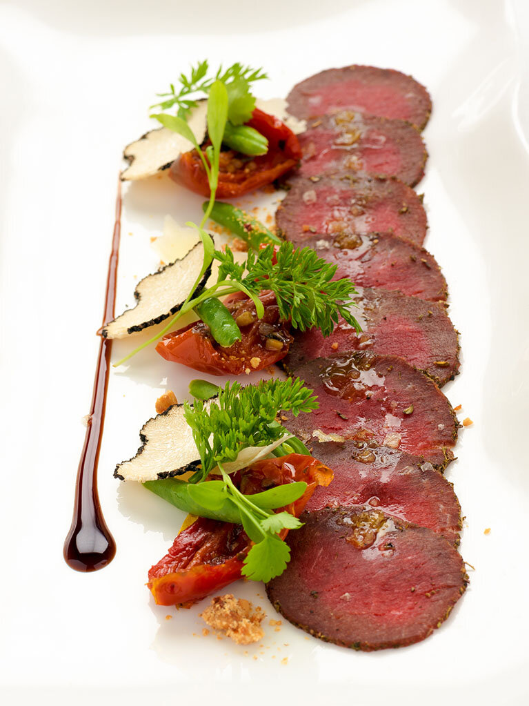 ENRICO GUSELLA'S VENISON CARPACCIO - This is my best recipe to combine Highland Red Deer with the first Black Truffle in season, I hope you will enjoy it.To plate up:200gr green beans30gr of Black TruffleSmoked Maldon SaltSun Blushed TomatoesTruffle Vinegar reduction20gr crushed HazelnutExtra Virgin Olive OilGrana Padano shavingsMicroherbsSERVES SIX