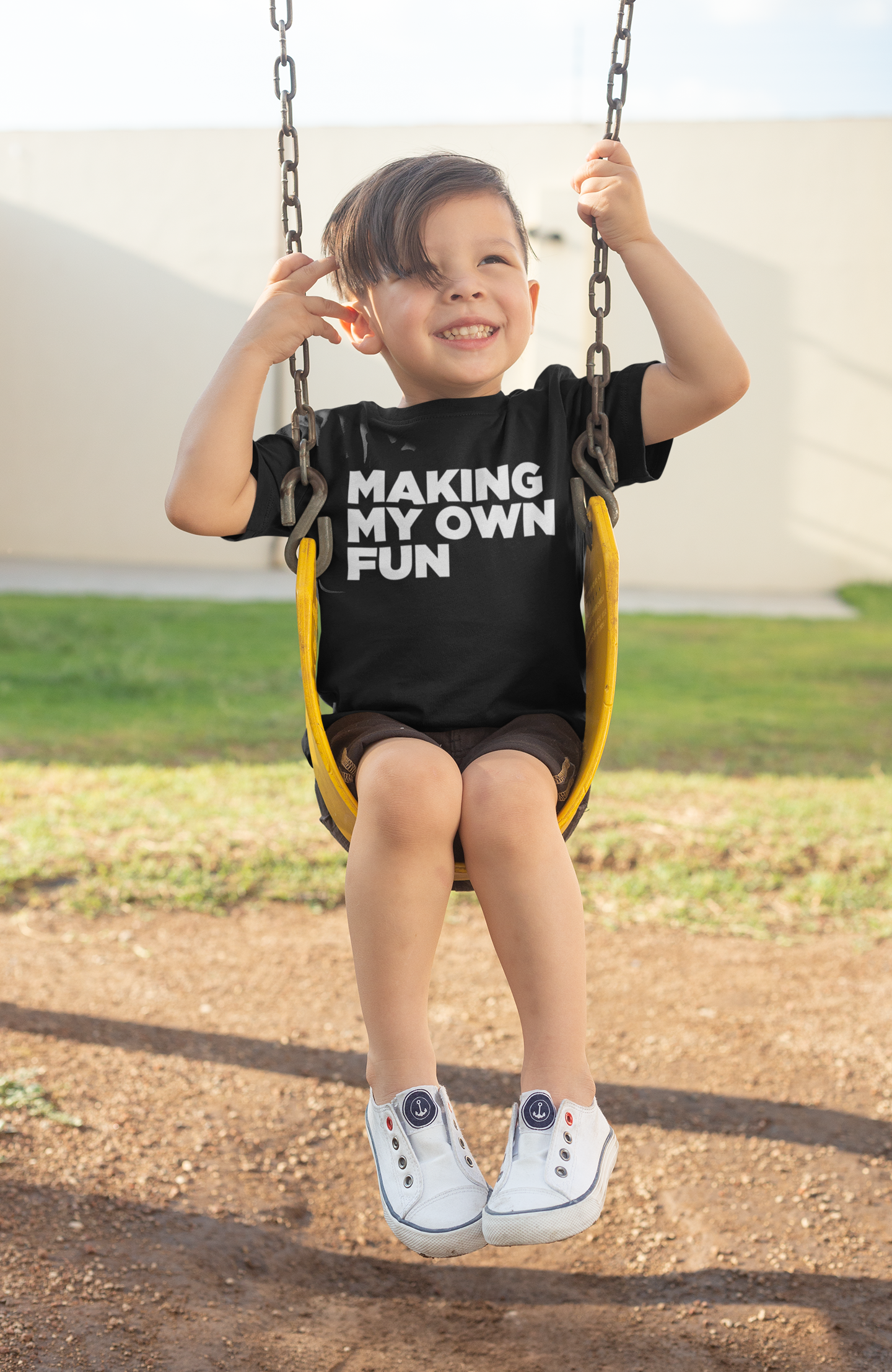 t-shirt-mockup-of-a-boy-playing-on-a-swing-28082.png