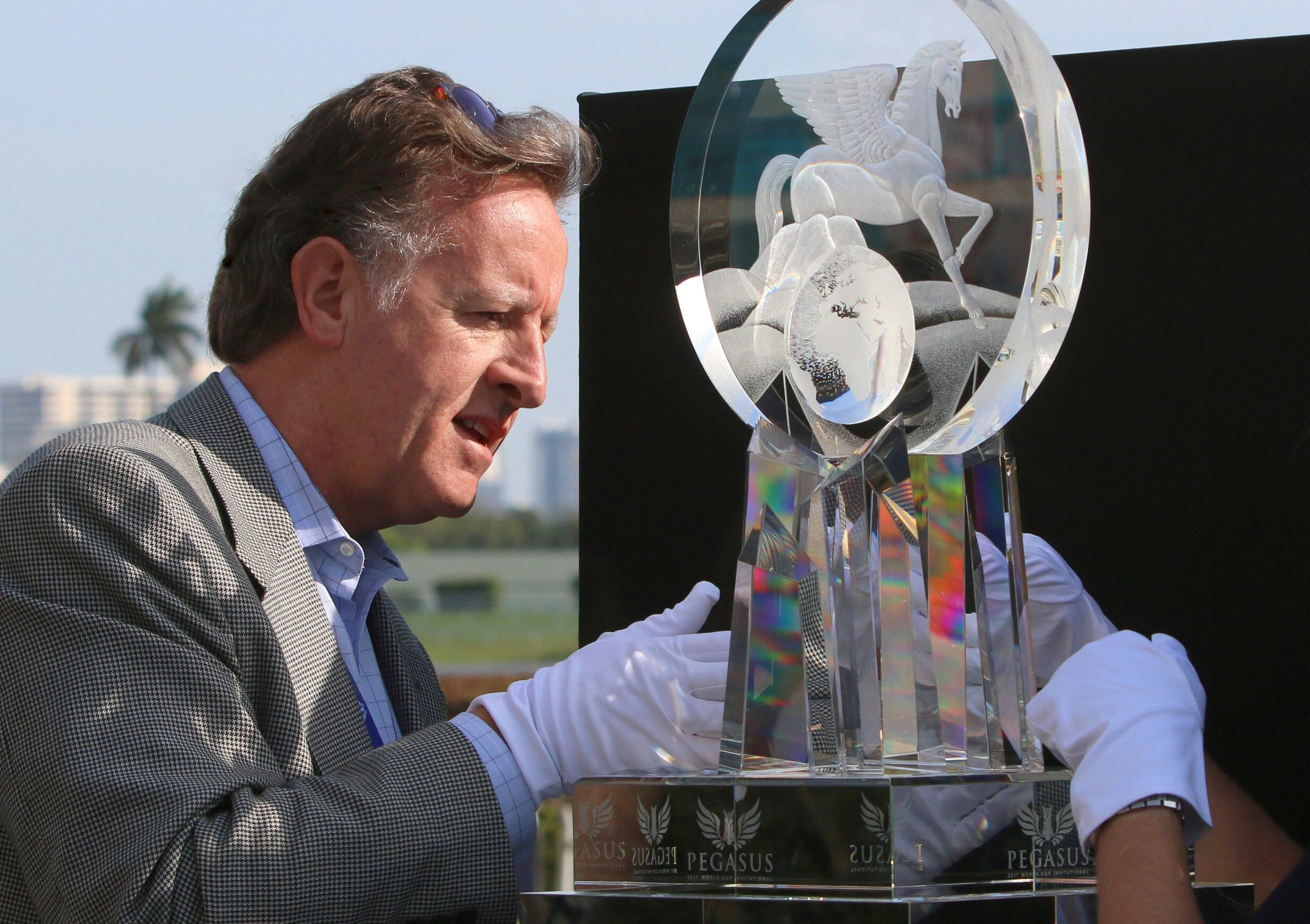 Mark Raynes Roberts, artist and designer of the Pegasus World Cup Invitational crystal trophy, puts the finishing touches to his trophy on race day morning at Gulfstream Park, Miami, Florida.