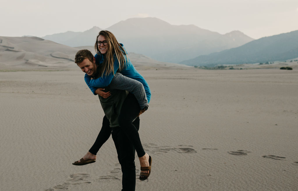 young couple wearing melanzana jackets exploring great sand dunes national park
