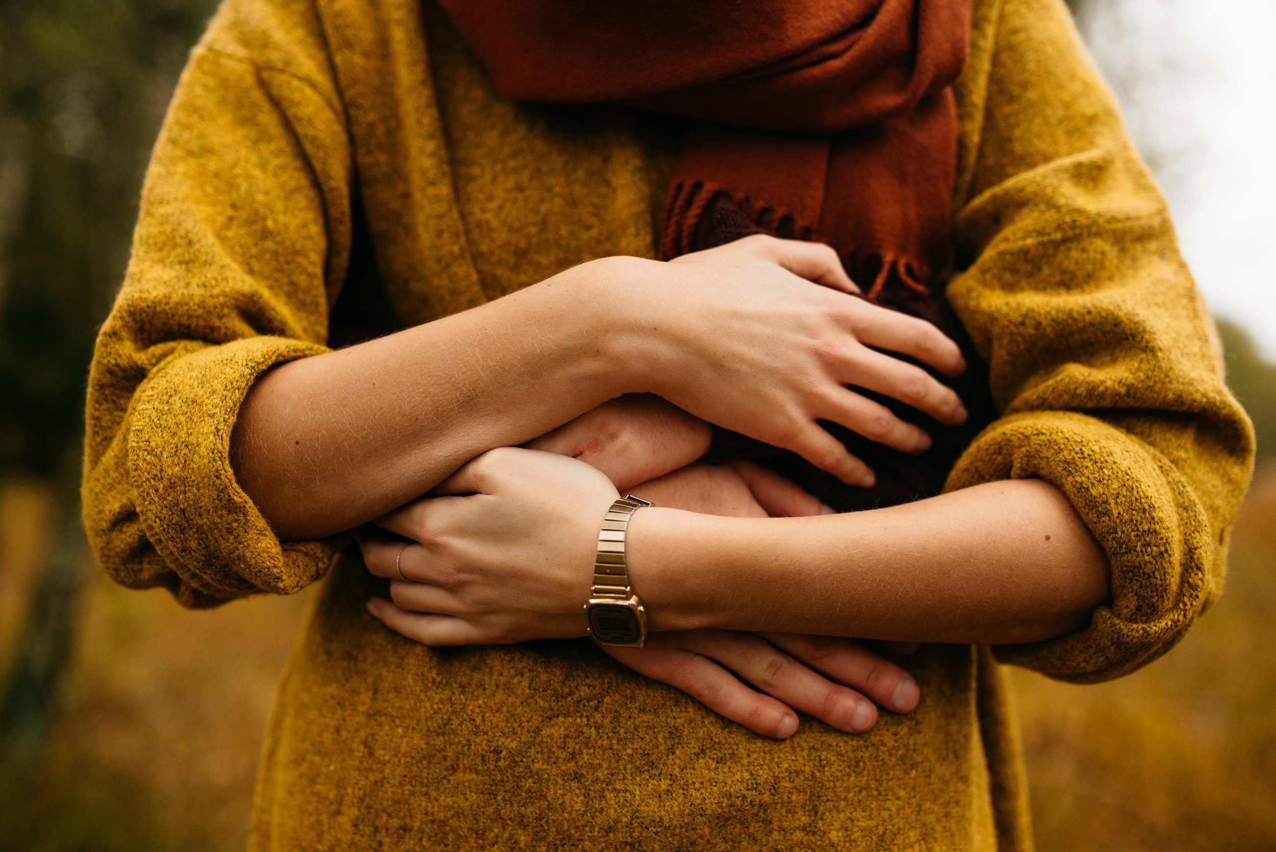 man holding woman partnership yellow hug embrace