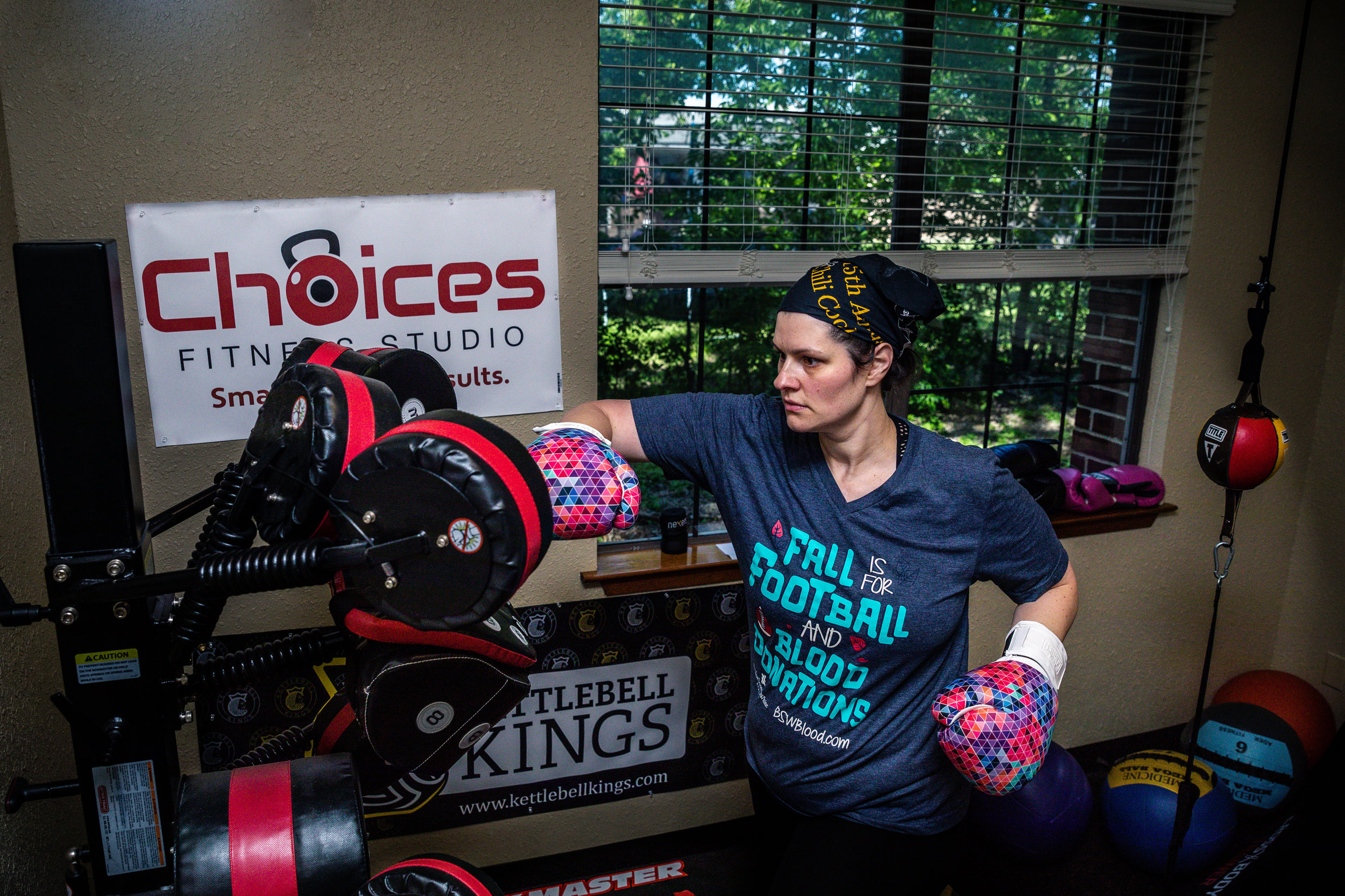 Erica lands a right during a Boxmaster workout at Choices Fitness Studio.