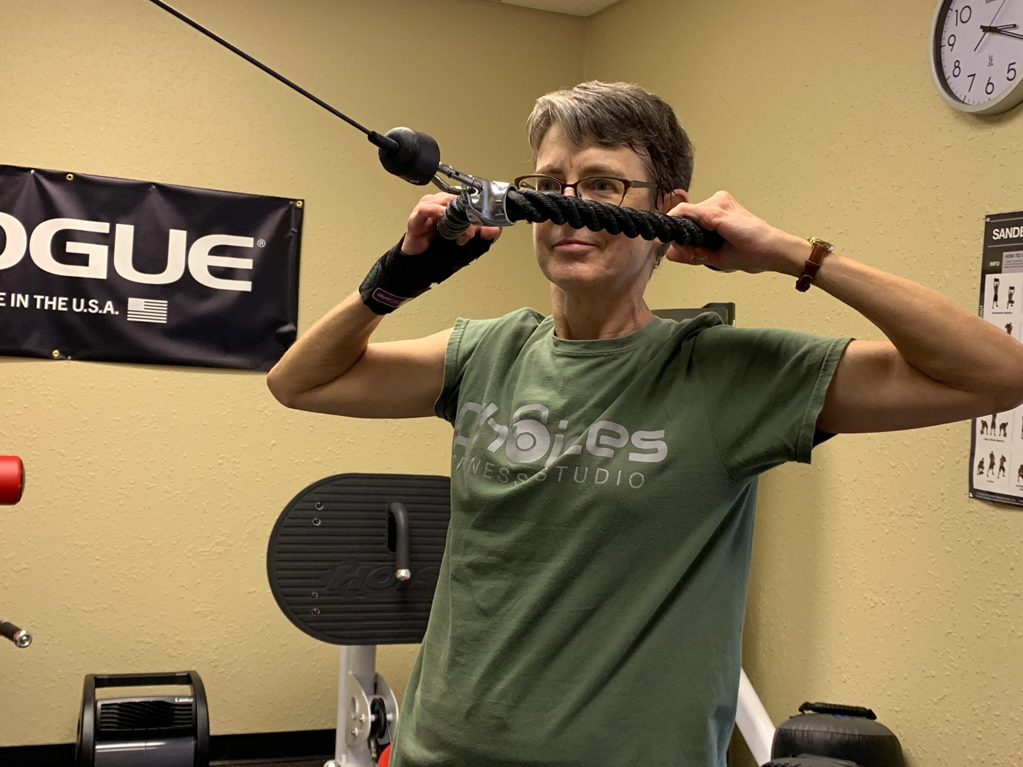 Kathy performs a Face Pull back exercise  during her 100th visit to Choices Fitness Studio. Choices uses circuit training to give clients a full-body workout that blends weight training, kettlebells, boxing fitness, cardio and Tabata intervals.