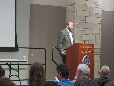 Chair Josh Layfield welcomes attendees to 2018 Winchell Symposium at St. Thomas.