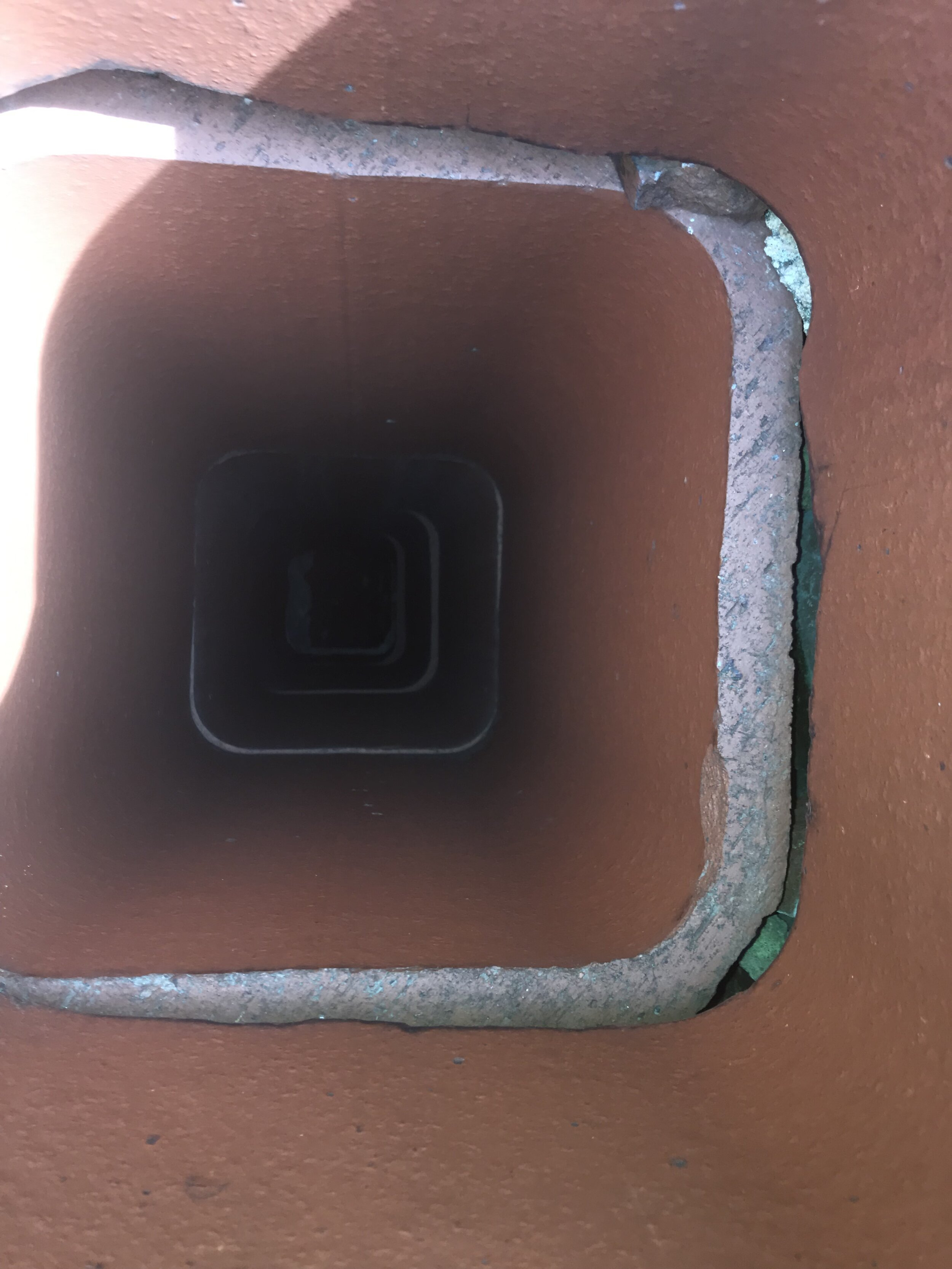 Clean flue, but gap between liners. Allows product of combustion to escape.jpg