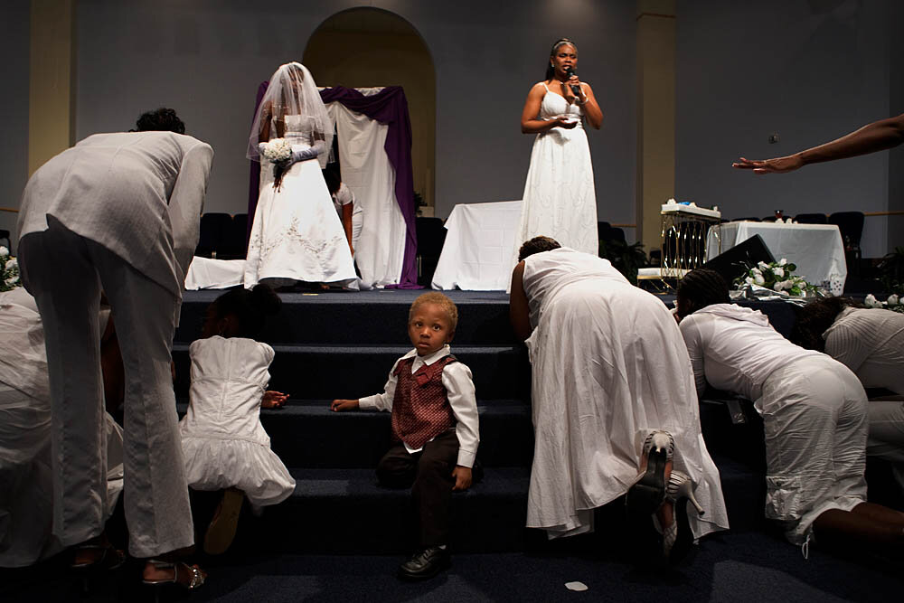 "Congregants pray at the altar during the Purity Ring Ceremony at the Destiny World Church June 16 in Austell, GA. Young children, teenagers and their parents or guardians came together for three days to promote abstinence. Issues like STDs, peer pressure, teen pregnancy, molestation and abuse were also main topics of panel discussions. The Holywood Retreat concluded with a Purity Ring Ceremony where each participant pledged to keep their virginity or to no longer participate in sex outside of marriage by wearing a ""purity ring"" on their wedding finger until the day it is replaced by a wedding ring. The three day event featured ministers and lay speakers, a fashion show that illustrated how one can remain modest and fashionable, a religious concert as well as other activities that entertained a predominantly young and energetic group."