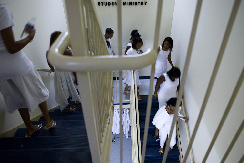 "Teens head to the front of the church for the Purity Ring Ceremony at the Destiny World Church June 16 in Austell, GA. Young children, teenagers and their parents or guardians came together for three days to promote abstinence. Issues like STDs, peer pressure, teen pregnancy, molestation and abuse were also main topics of panel discussions. The Holywood Retreat concluded with a Purity Ring Ceremony where each participant pledged to keep their virginity or to no longer participate in sex outside of marriage by wearing a ""purity ring"" on their wedding finger until the day it is replaced by a wedding ring. The three day event featured ministers and lay speakers, a fashion show that illustrated how one can remain modest and fashionable, a religious concert as well as other activities that entertained a predominantly young and energetic group."