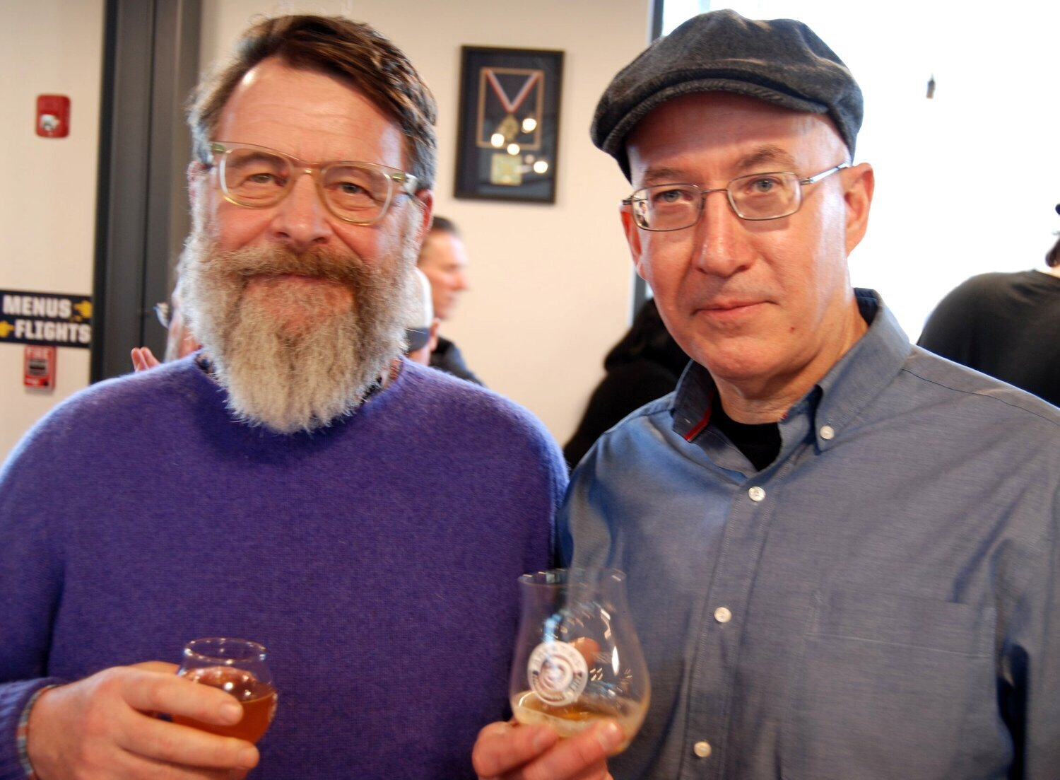 Cheers to CT Beers! - Dr. James Shepherd owner of Smokedown Farm (left) pictured with brewmaster Phil Markowski of Two Roads Brewing Company at the Area Two private grand opening.