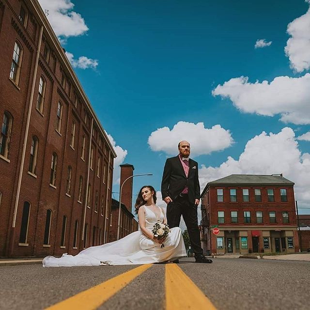 Married 07-27-2019 🥰💕😍 . . . 📸 @julierosillophotography @israel_rosillo  If you don't have these guys booked for your next shoot you're missing out! . . . . . [Image 1: Aubrey & Pat are in the middle of the road in their wedding clothes (white gown & black suit) with serious faces, looking away from each other and the camera. Image 2: Aubrey is looking over at pat and laughing. Pat is holding her bouquet. Image 3: A black and white photo of Aubrey in her wedding gown, shot from the back.] . . . . .  #finallyfarabaugh #farabaughwedding #mrandmrsfarabaugh #newlyweds #altoona #altoonawedding #centralpaweddings #stunning #summerwedding #julierosillophotography #industrialwedding #sherrihill #succulentbouquet #hotgirlsummer #fitbride