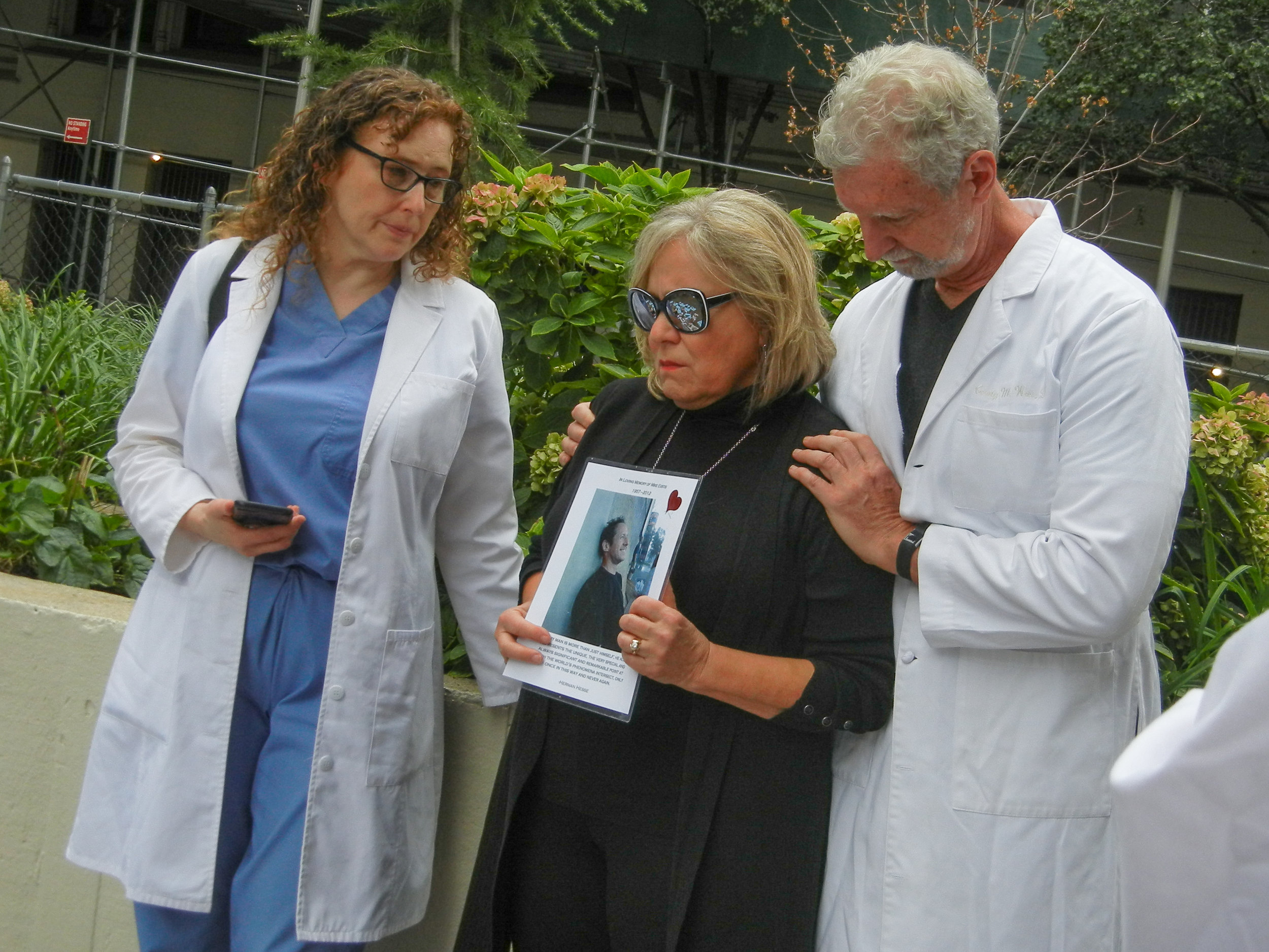 Dr. Pamela Wible (left) led a memorial service in honor of Dr. Deelshad Joomun, a Mt. Sinai resident lost to suicide in January 2018, and invited parents and friends of the lost to speak | Carolyn Adams