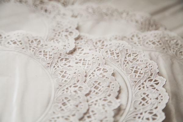 2.   Fold each doily in half  - This is to find the centre of the doily.