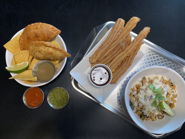 Empanadas, Churros and Grilled Elote Salad from MidNord at Graze Provisions + Libations in Minneapolis' North Loop. Photographed Sept. 5, 2019. (Nancy Ngo / Pioneer Press)