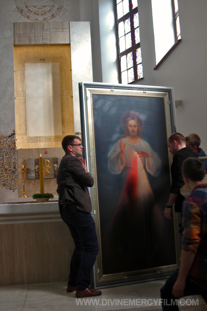 With the bare wall in the background where the painting is on permanent display, the Original Image of Divine Mercy was encased in special a wooden and plexiglas box for a once-in-a-lifetime trip into the city of Vilnius.