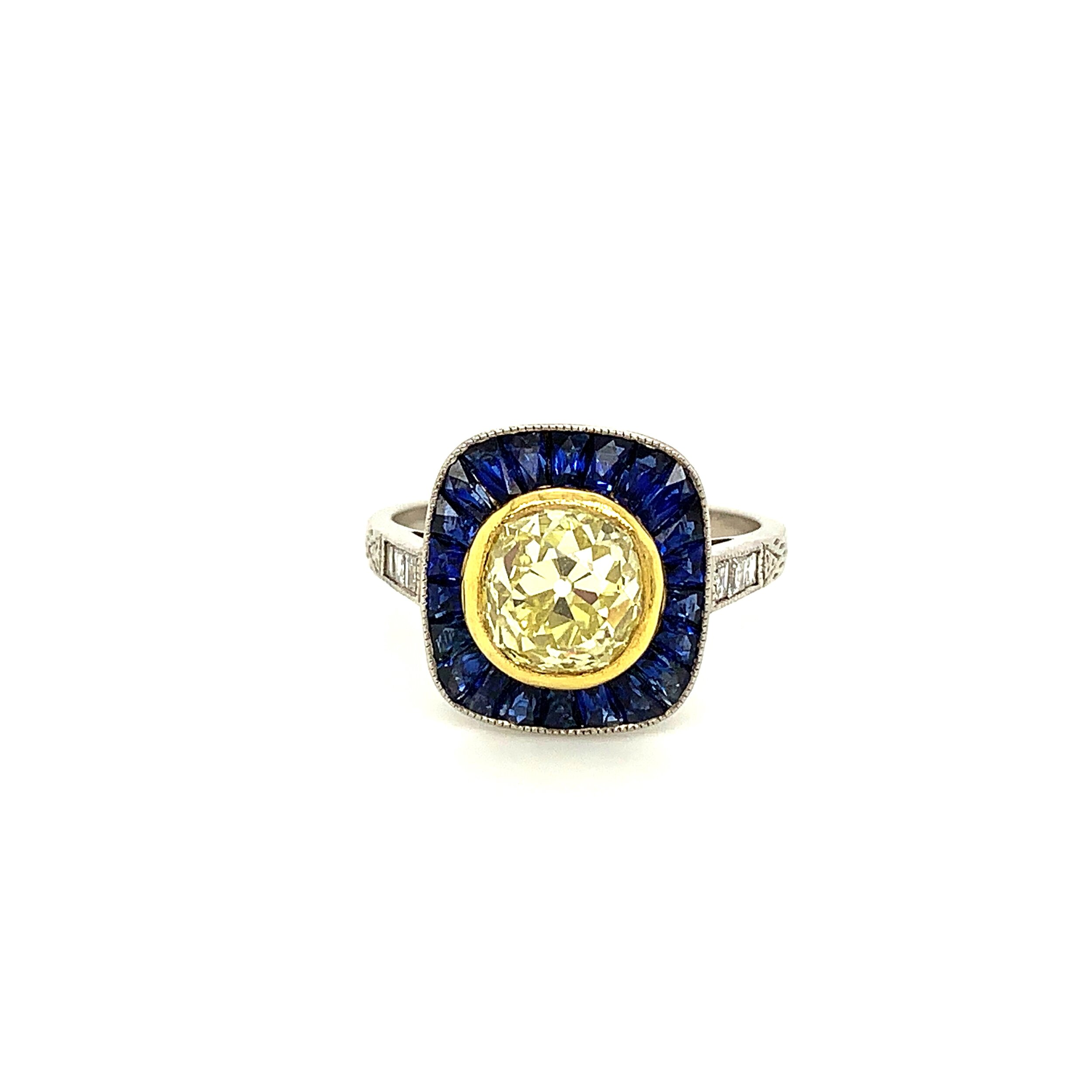 Deco-Style Fancy Yellow Solitaire Ring Surrounded with Sapphires.  Est. US$ 12,000-15,000