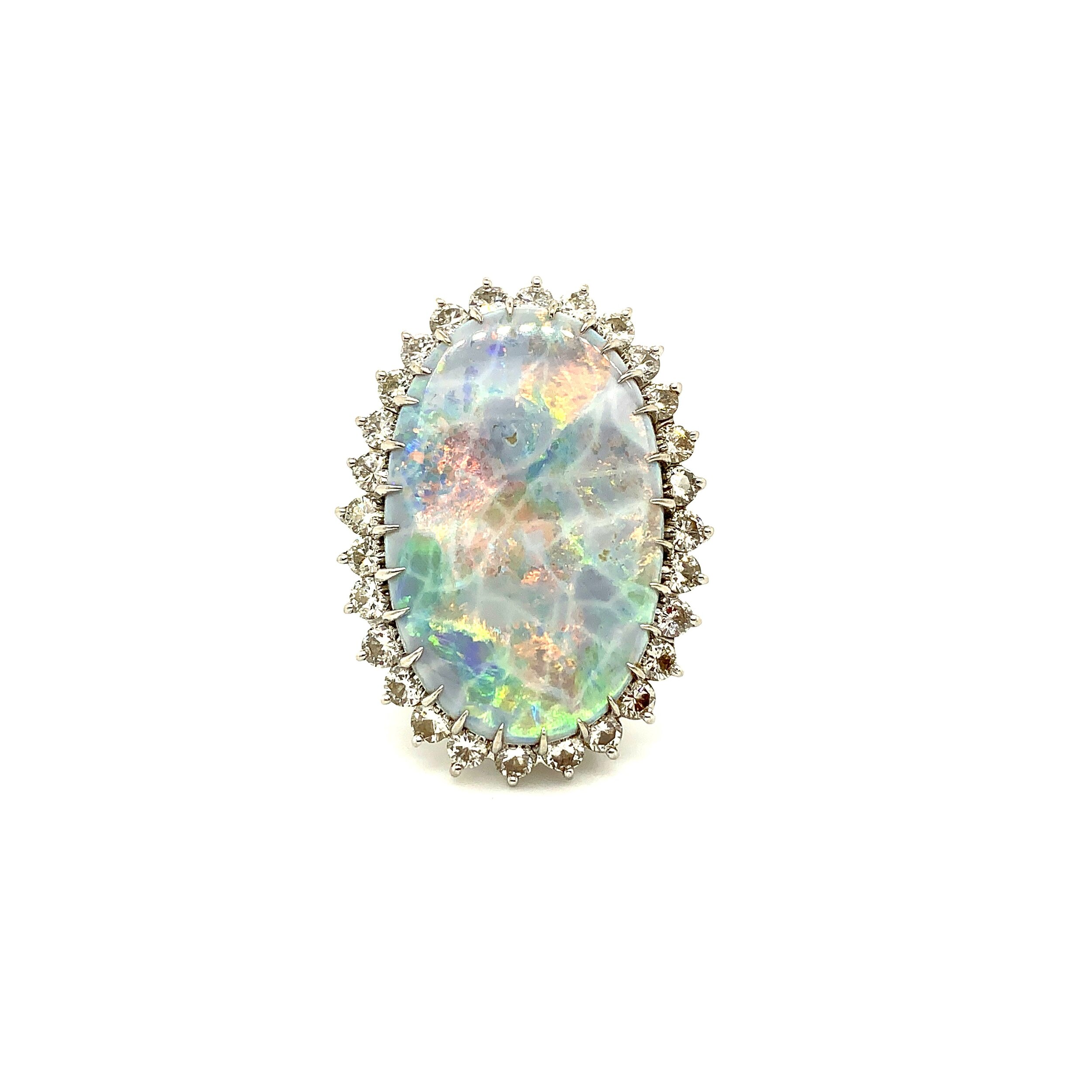 10ct Black Opal Ring with 2.75ct Diamond Mounting in 14 Karat Gold  Est. US$ 2,500-4,000