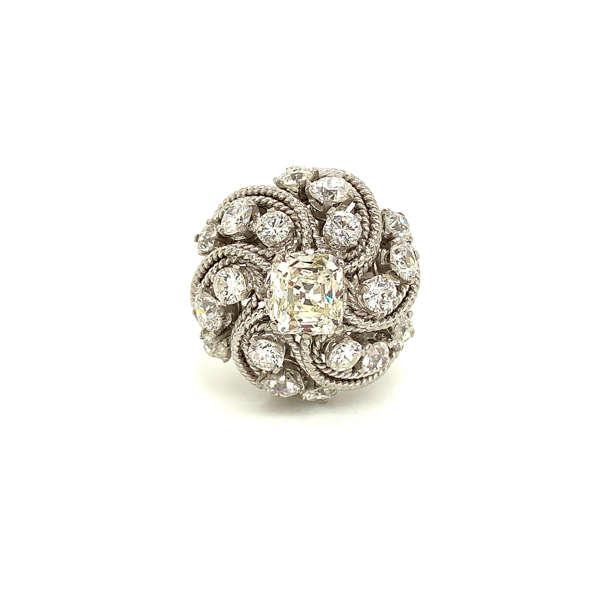 Diamond Cluster Ring with Square-Cut 1.7ct Diamond Center Set in Platinum  Est. US$ 3,000-5,000