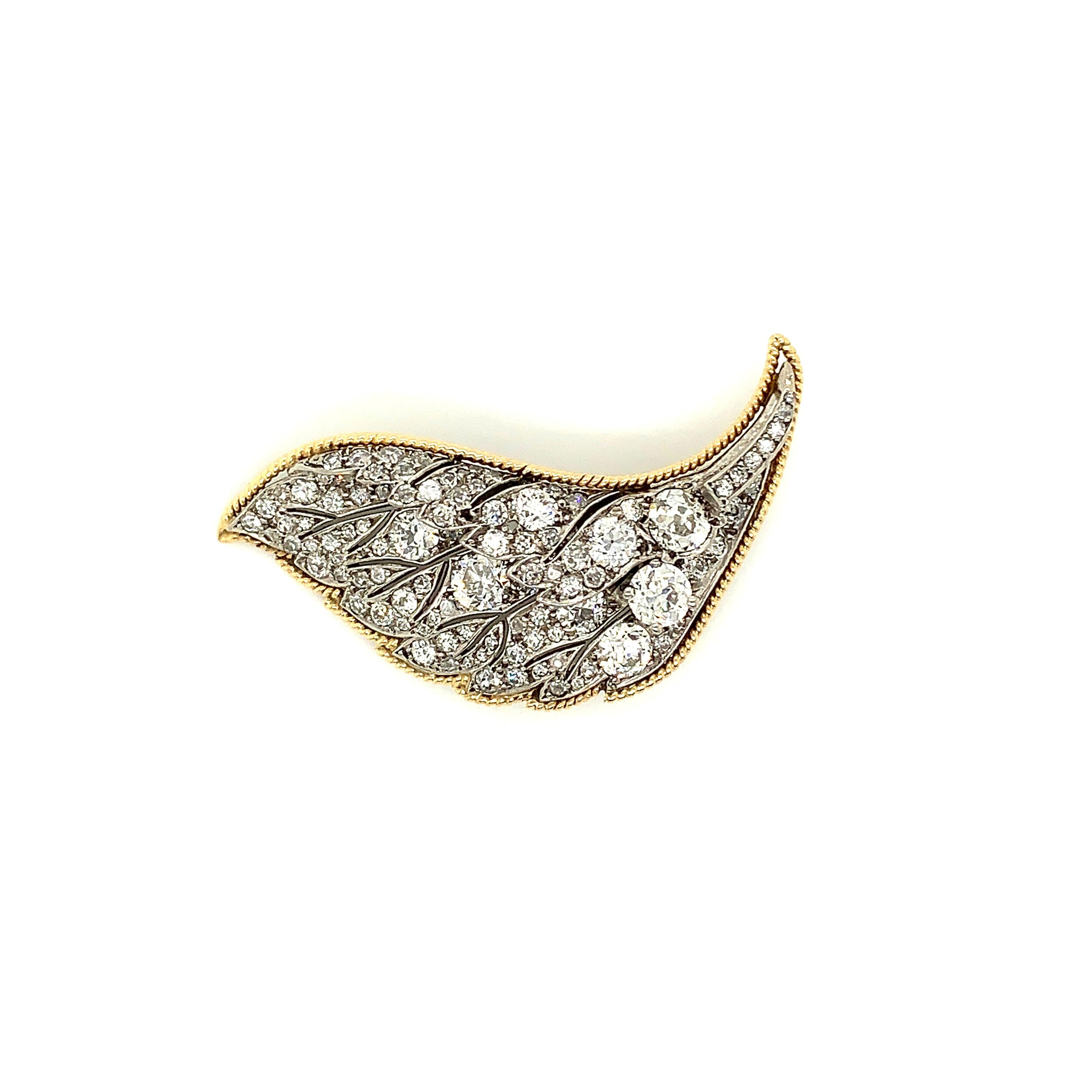 2.4ct Diamond Leaf Brooch set in White and Yellow Gold  Est. US$ 2,500-3,500