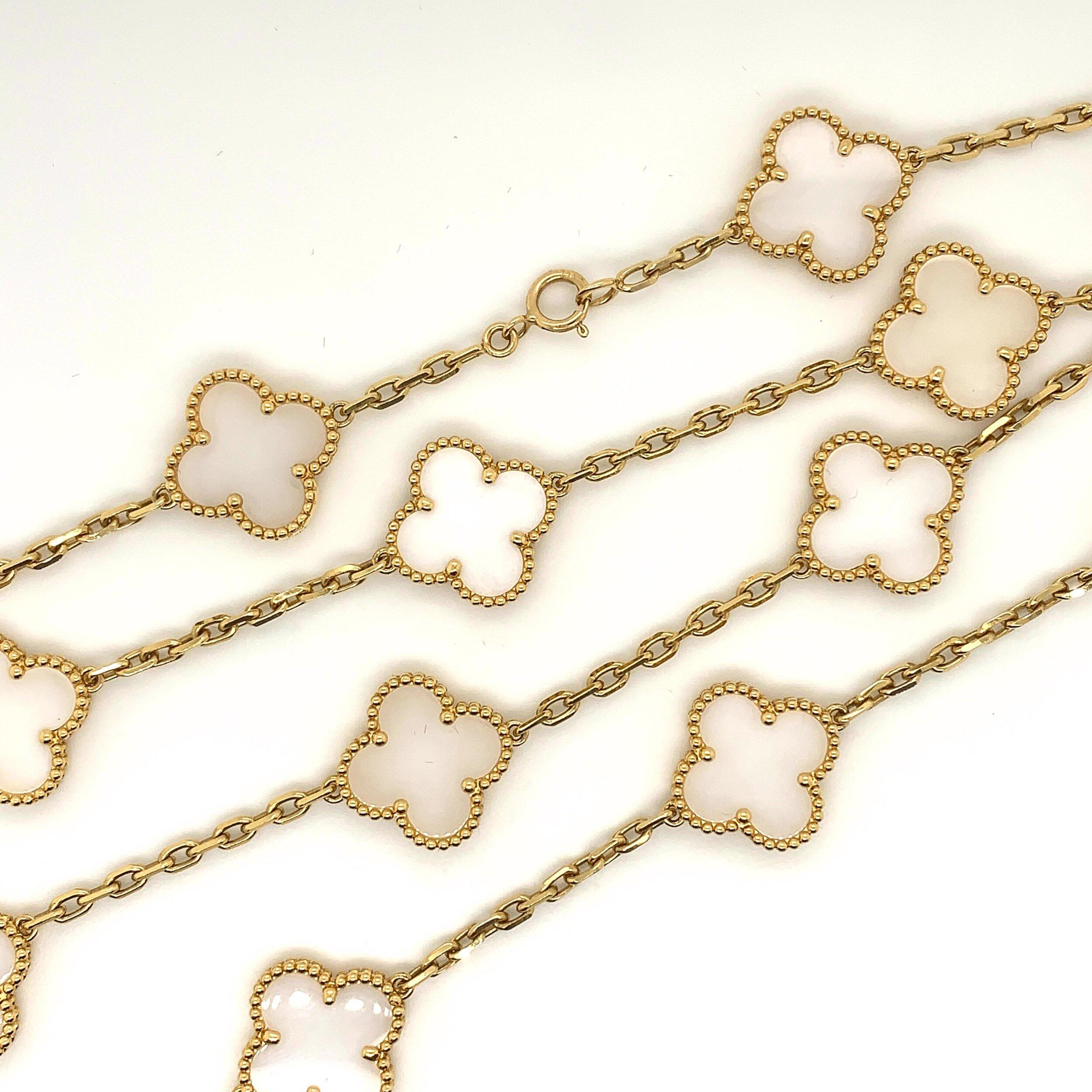 Van Cleef & Arpels 20 Motif Alhambra Gold and White Coral Necklace   Est. US$ 30,000-35,000