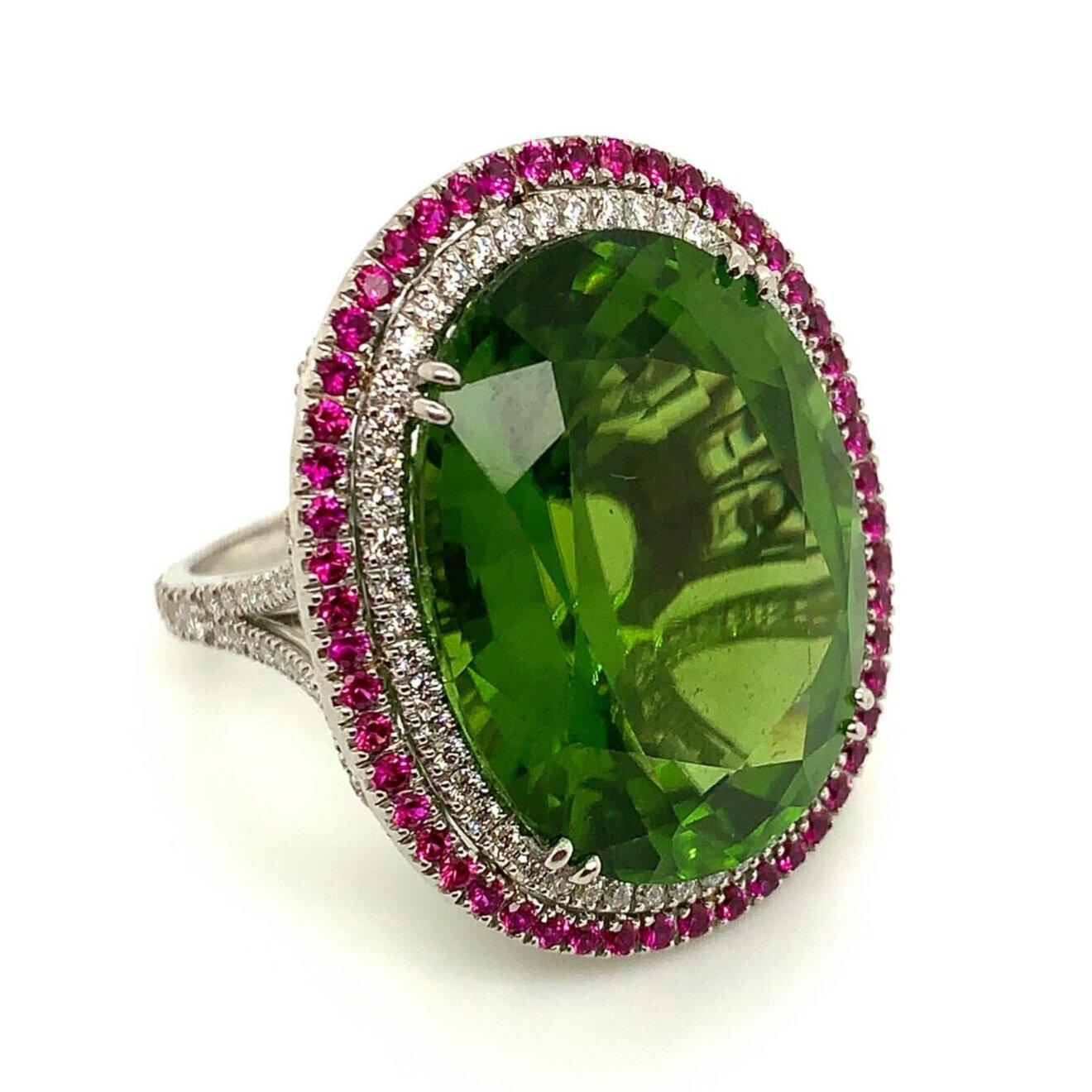 Platinum Peridot Ring with Tiny Rubies and Diamonds   Est. US$ 6,500-7,500