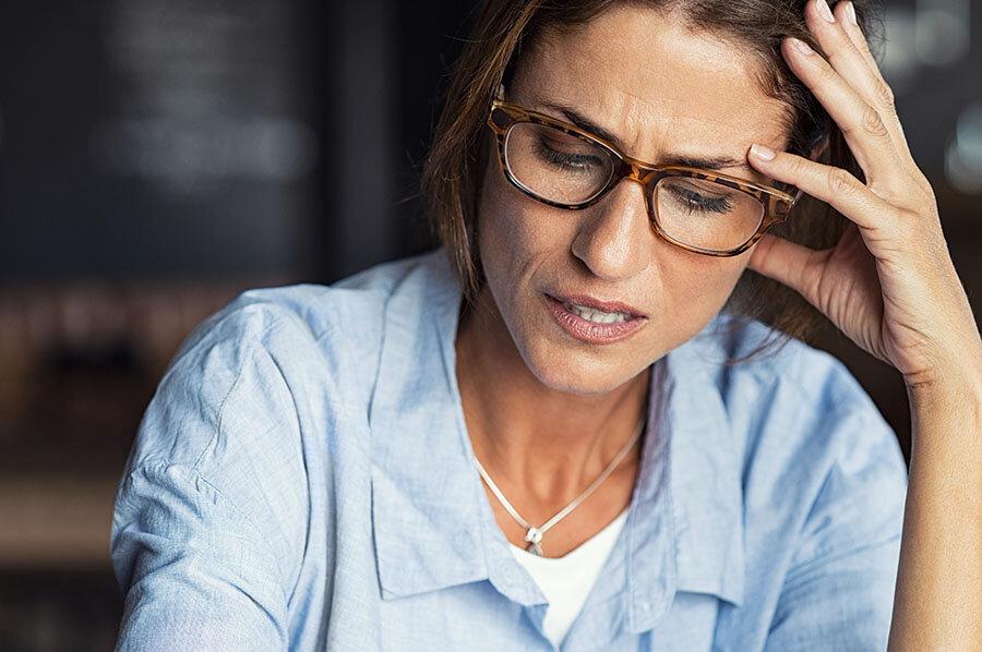 Stressed woman wearing eyeglasses