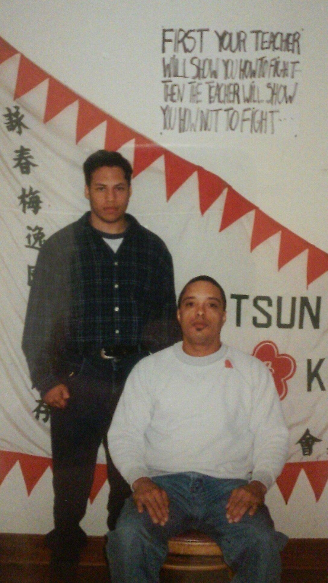 Sifu Barry O'Brien standing next to his teacher, Grandmaster Moy Tung.