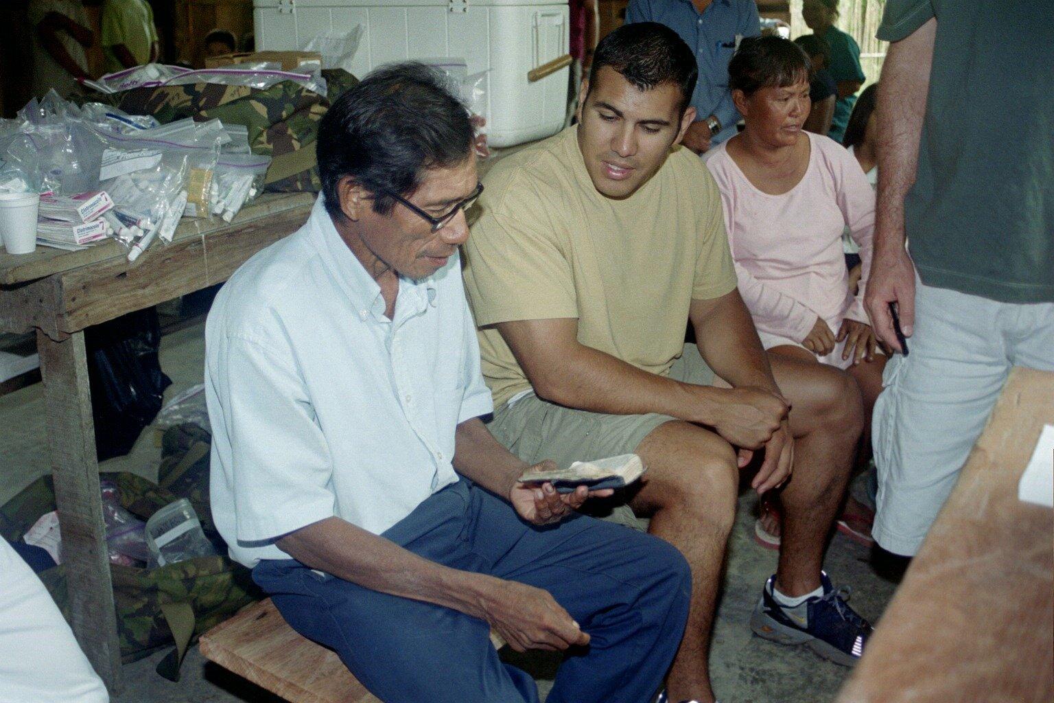 reading his bible.JPG