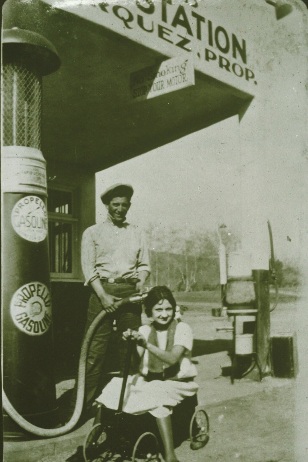 Early image of the filling station A ngie Marquez Collection