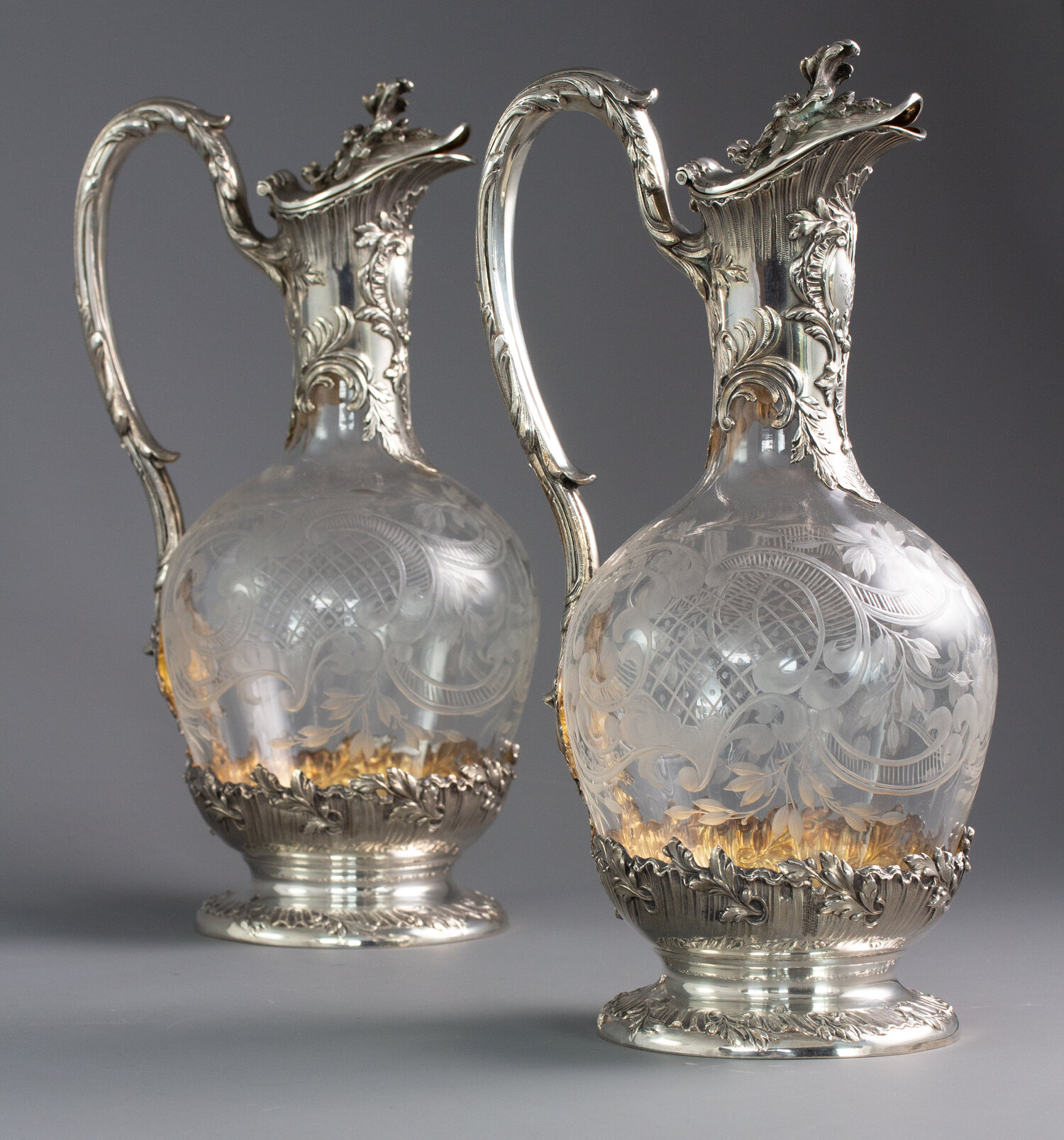 An exceptional pair of late 19th century French silver and crystal claret jugs.   Forrest & Fraser - P12